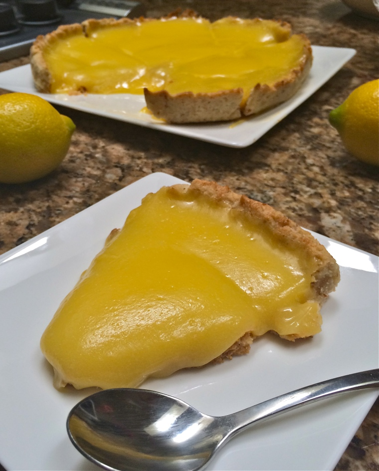 Lemon Curd Tart | KellyintheKitchen | Ingredients: butter, sugar, eggs, lemon juice, ground almonds, flour, water, parchment paper